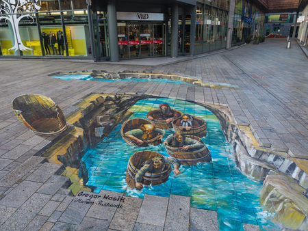 ALMERE, NETHERLANDS - 27 OCT. 2015: Painting by unknown artist shows the power of 3D optical illusion of a street painting. Once a year the city of Almere allows artists to create street art