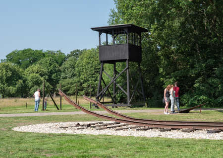 auschwitz memorial: WESTERBORK, NETHERLANDS - 13 AUG. 2015: Watchtower and railway track at former Nazi transit camp Westerbork. In WWII 100.00 jews and roma were transported from here to German concentration camps