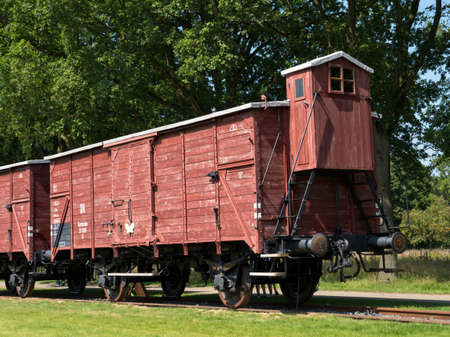 auschwitz memorial: WESTERBORK, NETHERLANDS - 13 AUG. 2015: Railway wagon at former Nazi transit camp Westerbork. in WWII 100.00 jews and roma were transported from here to concentration camps in occupied Poland