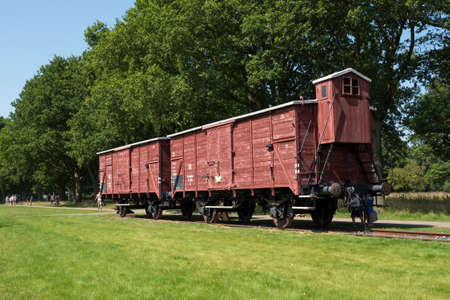 transported: WESTERBORK, NETHERLANDS - 13 AUG. 2015: Railway wagon at former Nazi transit camp Westerbork. in WWII 100.00 jews and roma were transported from here to concentration camps in occupied Poland