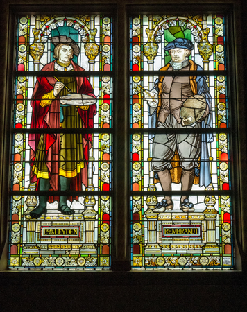 rembrandt: AMSTERDAM - 2 JULY 2014: Stained glass windows depicting the painters Rembrandt and Van Leyden in the central hall of national Rijksmuseum. The museum attracts more than 2 million visitors each year