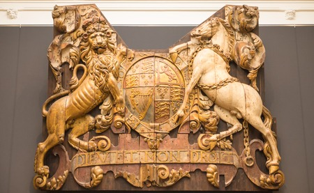 motto: Wooden coat of arms with the inscription Dieu et mon Droit, meaning God and my Right. This is the motto of the monarchs of the United Kingdom Stock Photo