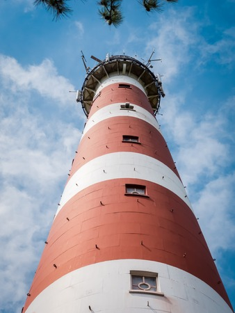 View up the lighthouse on the island of Ameland in the Dutch Waddenzee