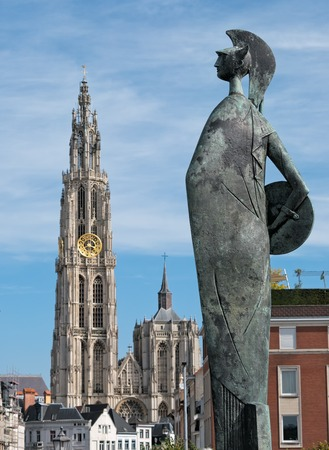 Statue of goddess Minerva near the river Scheldt in Antwerp, Belgium with the cathedral showing in the background