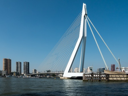 maas: ROTTERDAM, NETHERLANDS - 15 SEPT. 2016: View on the Erasmus Bridge, also called The Swan, on the Maas river in Rotterdam. The city has Europes largest container port