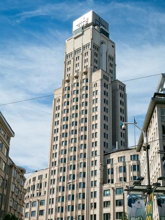 ANTWERP, BELGIUM - 10 SEPT. 2016: De Boerentoren in Antwerp, a landmark building in art-deco style, was built in 1931 as Europe's first skryscraper. This historic building now houses offices Éditoriale
