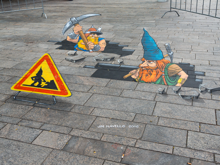 gnomos: ALMERE, NETHERLANDS - 24 OCT. 2017: Street art of gnomes breaking through the street by an unknown artists shows the power of 3D optical illusion in Almere.