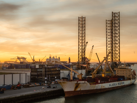 ijmuiden: Oil platform Atlantic and cargo ship Chilean Reefer in the port of IJmuiden Editorial