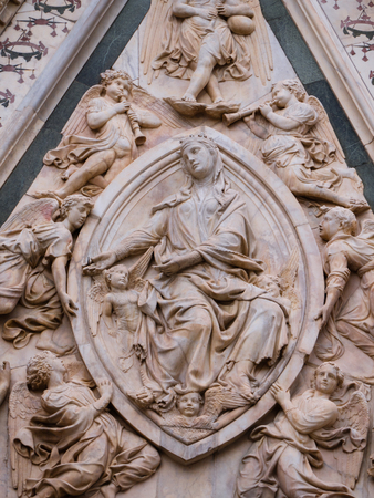Detail of the Madonna of the Girdle at the portal of the Caetehdral of Santa Maria del Fiore in Florence