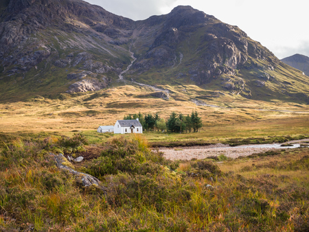Climbers cottage at Lagangarbh close to Buachaille Etive Mor and Buachaille Etive Beag as seen from the River Coupall in the Glen Coe area, Scotland
