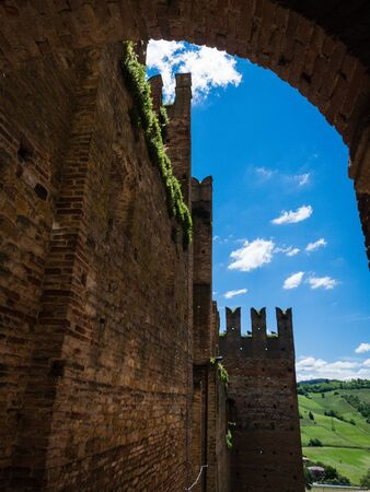 View up the Rocca Viscontea in the town of Castell Arquato in Emilia-Romagna, Italy