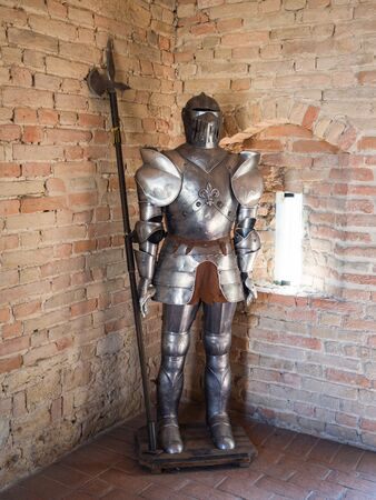 Knight in medieval armor with battle axe