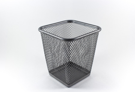 Empty metal basket on white background photo