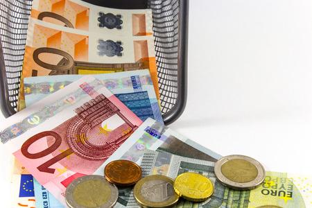 Euro banknote in metal basket, white background photo