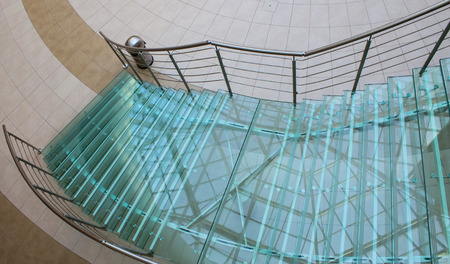 view of a staircase in a shop: Staircase made by glass