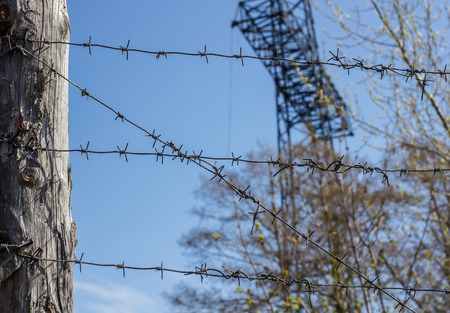 concentration camp: Barbed wire fence in industrial zone