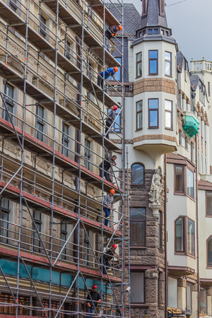 RIGA, LATVIA - JUNE 26, 2014. Reconstruction of building in the Old Town on 26 June 2014.  Old Town is the most popular touristic place in Riga. Editorial