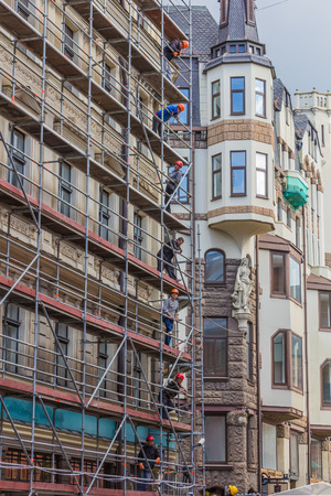 sectarian: RIGA, LATVIA - JUNE 26, 2014. Reconstruction of building in the Old Town on 26 June 2014.  Old Town is the most popular touristic place in Riga. Editorial
