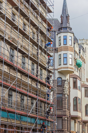 barndoor: RIGA, LATVIA - JUNE 26, 2014. Reconstruction of building in the Old Town on 26 June 2014.  Old Town is the most popular touristic place in Riga. Editorial