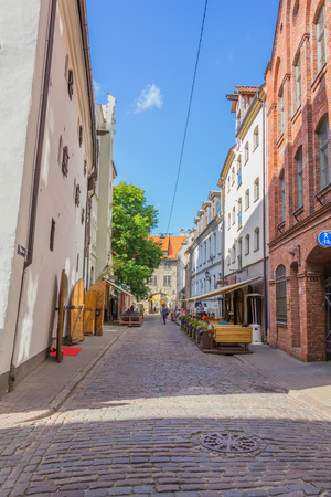 RIGA, LATVIA - JUNE 26, 2014. View of street in the Old Town on 26 June 2014.  Old Town is the most popular touristic place in Riga. Editorial