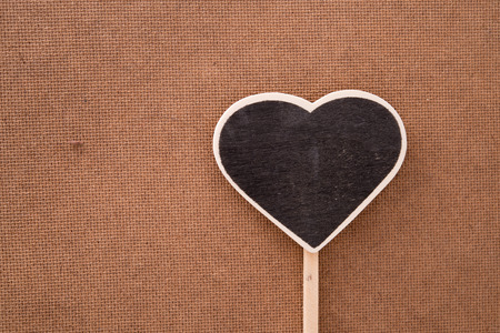 hardness: Heart on wood shows the sensitivity to hardness. Stock Photo