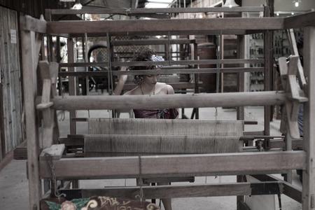 loom: Antique loom for weaving.