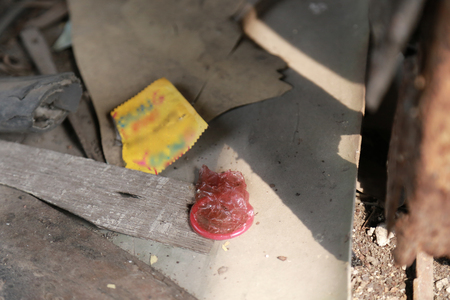 Condoms with sperm stains after fucking on abandoned trains. Фото со стока