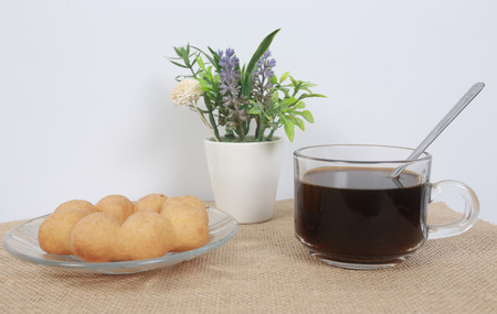 Black coffee on a white table Stock Photo