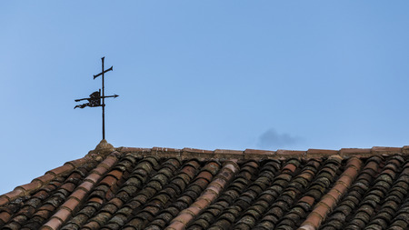 vane: old weather vane on the roof of a church Stock Photo