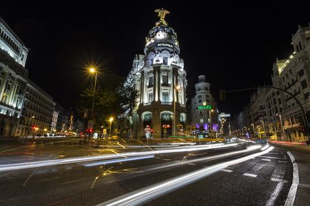 gran via: Night image of the intersection of Calle Alcala and Gran Via in Madrid Editorial