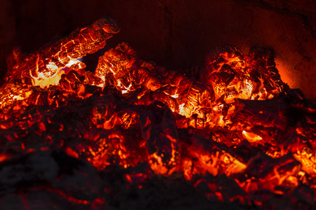 wood embers in a fireplace Stock Photo