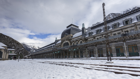 Abandoned old train station in Canfranc, in Spanish Pirineos mountain, near of the border of France. Photo taken in winter after a snowfall.