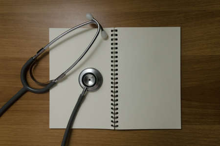 open book with stethoscope photo