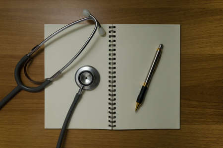 pen and stethoscope on book