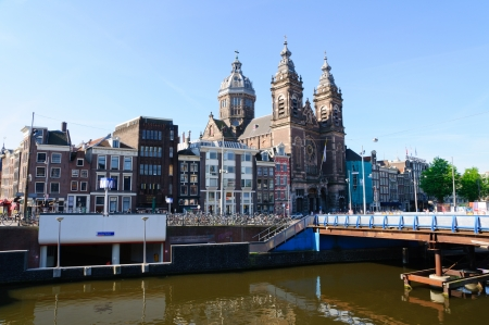 amstel river: St Nikolaaskerk in Amsterdam, Netherlands Editorial