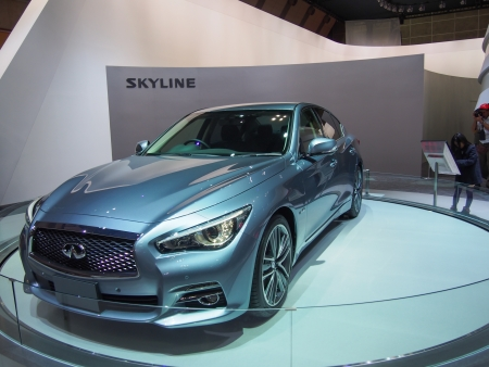 infiniti: TOKYO, JAPAN - November 23, 2013  New Skyline  Infiniti Q50  at the Booth of Nissan Motor The Tokyo Motor Show is a biennial auto show at the Tokyo Big Sight in Odaiba, Tokyo for cars, motorcycles and commercial vehicles  The Show is the biggest auto show