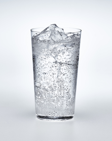 carbonated water with ice in the clear transparent glass