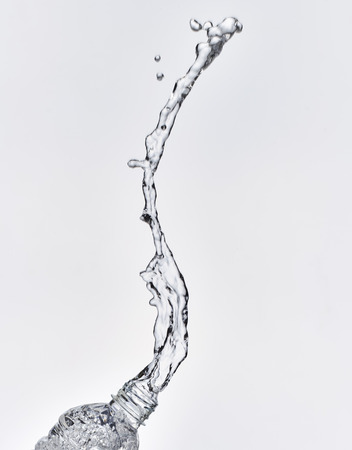 splash water coming out of the bottle