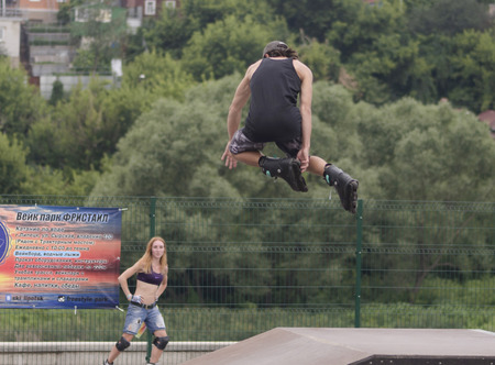 lad: Lad makes stunt on roller skates on festival extreme sports in city Elice Editorial