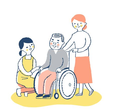 Female care staff and wheelchair senior men and wives Stock Photo