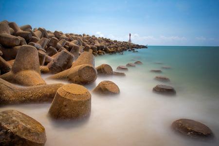 breaker: Beautiful waves breaker seascape scenery during mid day on sea shore at Terengganu, Malaysia.Soft focus during long exposure shoot.
