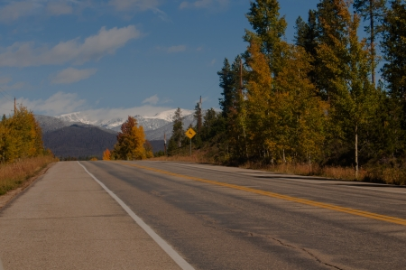 Highway to snow capped mountains photo
