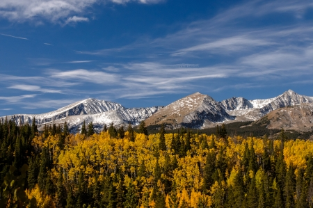 Autumn colors and snow covered peaks Stock fotó