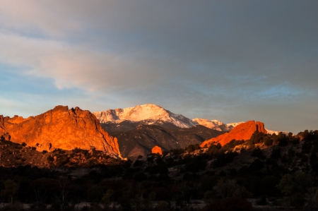 Sunrise glow over Pikes Peak and Garden of the Gods photo
