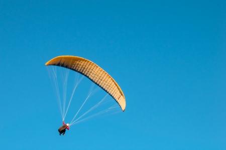 Parachute gliding through the air photo