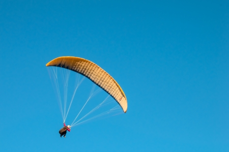 restraints: Parachute gliding through the air Stock Photo