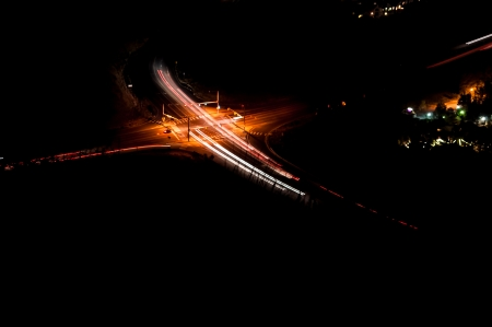 Car and town lights at roadway intersection photo