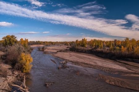 Roaming creek through fall colored trees Stock fotó