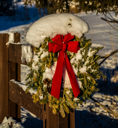fence post: Christmas wreath handing on fence post