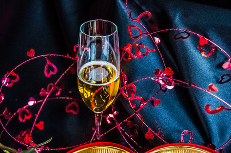 bubbly: Bubbly champagne in glass with Valentine tinsel